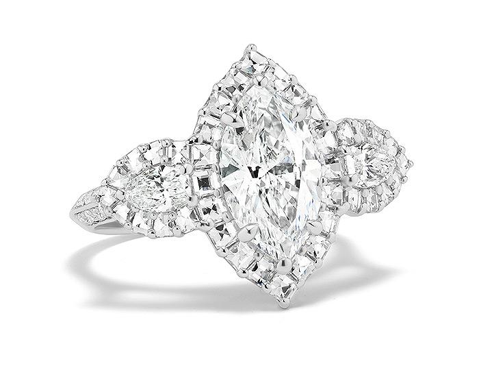 Bez Ambar marquise cut, blaze cut and round brilliant cut diamond engagement ring in platinum.