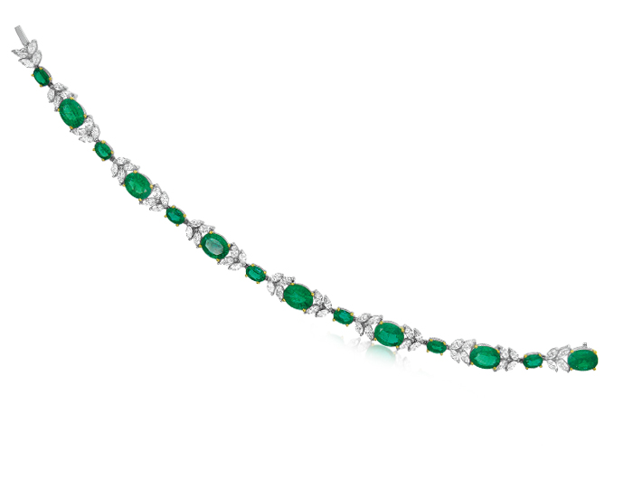 Emerald and marquise cut diamond bracelet in 18k white and yellow gold.