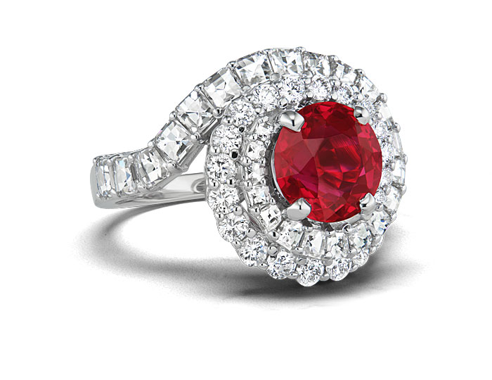 Round burmese ruby and round brilliant cut diamond ring in 18k white gold.