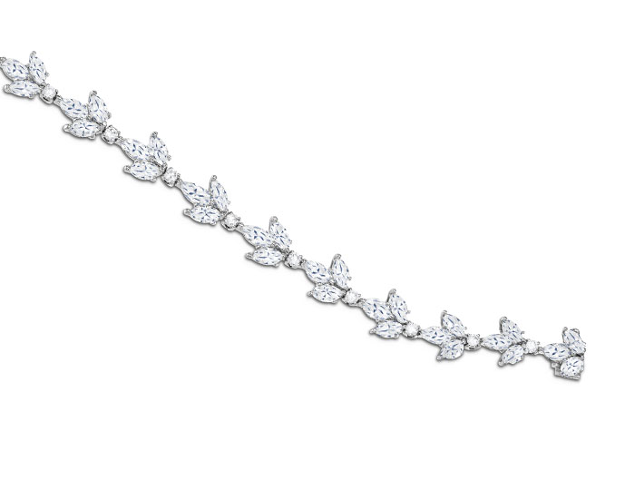 Marquise cut and round brilliant cut diamond bracelet in platinum.