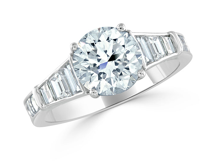 Round brilliant cut, trapezoid cut and blaze cut diamond engagement ring in platinum.