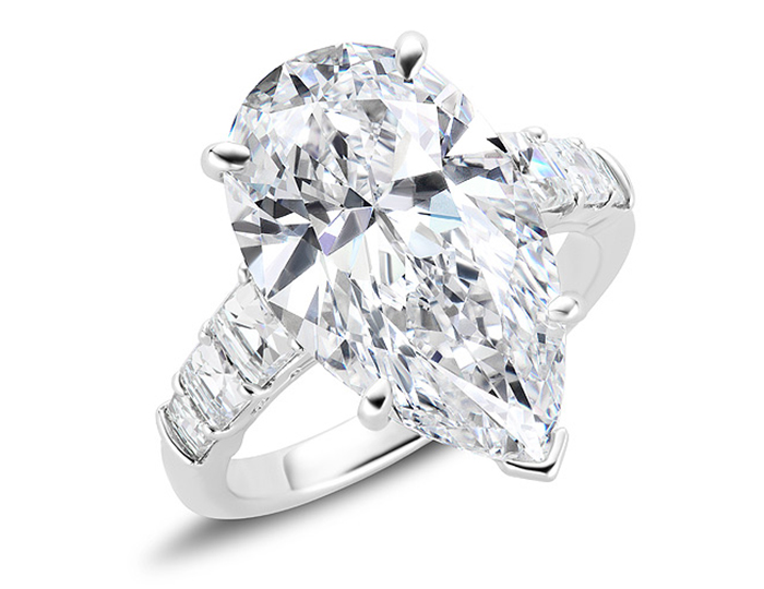 Pear shape and blaze cut diamond engagment ring in platinum.