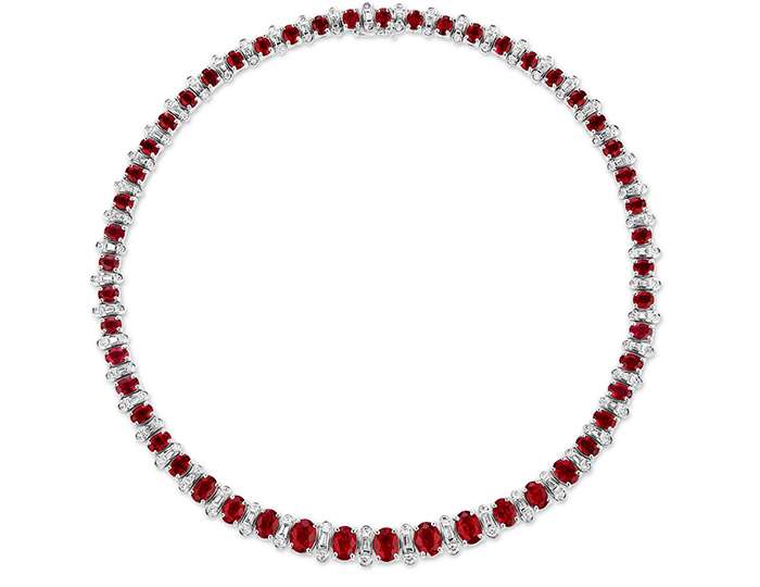 Ruby and round brilliant cut and baguette cut diamond necklce in 18k white gold.