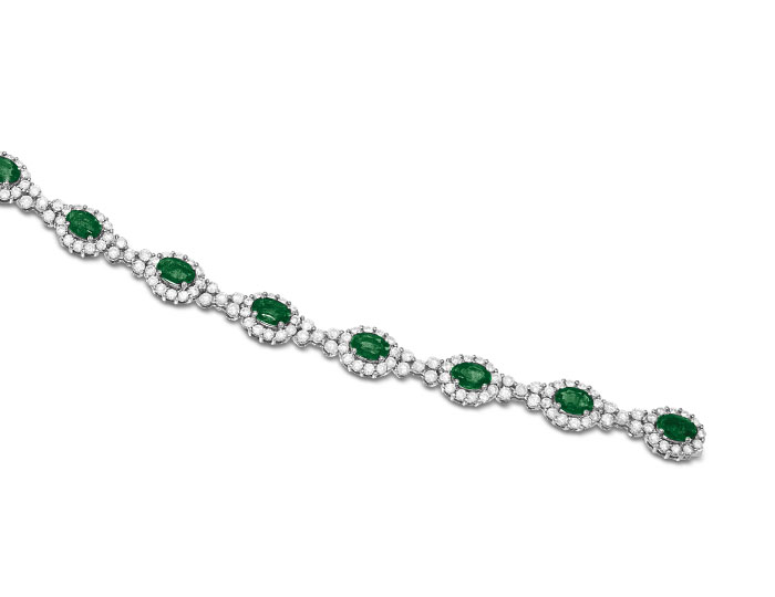 Emerald and round brilliant cut diamond bracelet in 18k white gold.