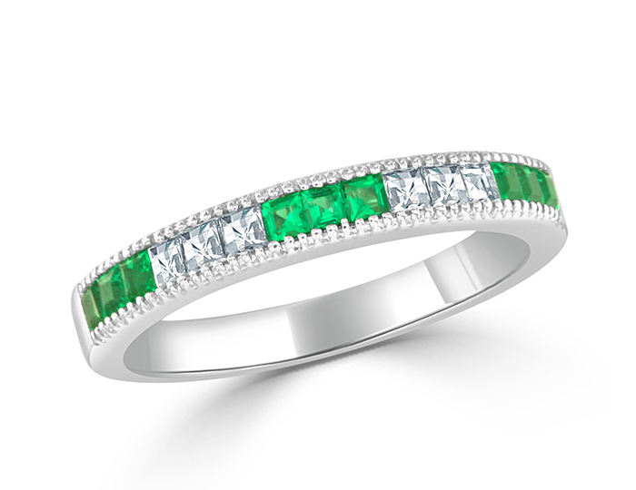 Emeralds and blaze cut diamond band in 18k white gold.