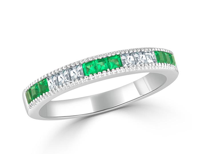 Emeralds and blaze cut diamond band in 18k white gold.
