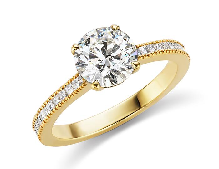 Bez Ambar round brilliant cut and blaze cut diamond engagement ring in 18k yellow gold.