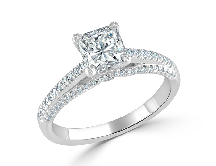 Radiant and round brilliant cut diamond engagement ring in 18k white gold.