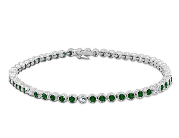 Casato round emerald and round brilliant cut diamond bracelet in 18k white gold.