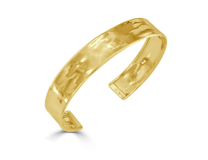 Cuff bracelet in 18k yellow gold.