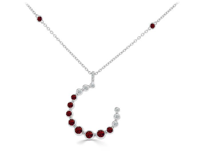 Casato ruby and round brilliant cut diamond necklace in 18k white gold.