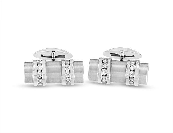 Round brilliant cut diamond cufflinks in 18k white gold.