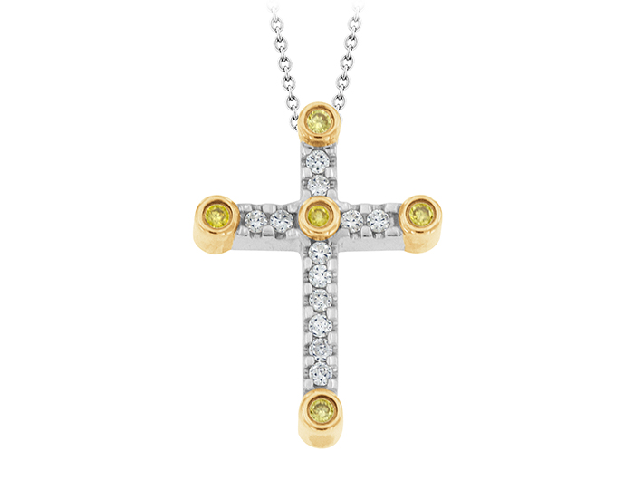 Round brilliant cut white and yellow diamond cross in 18k white and yellow gold.