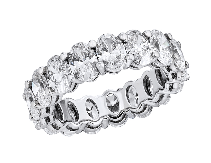Oval cut diamond eternity band in platinum.