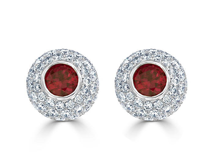 Ruby and round brilliant cut diamond earrings in 18k white gold.