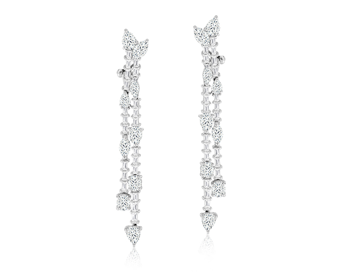 Pear cut, oval cut, marquise cut and baguette cut diamond earrings in platinum.
