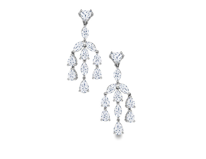 Trillion and pear cut diamond earrings in platinum.