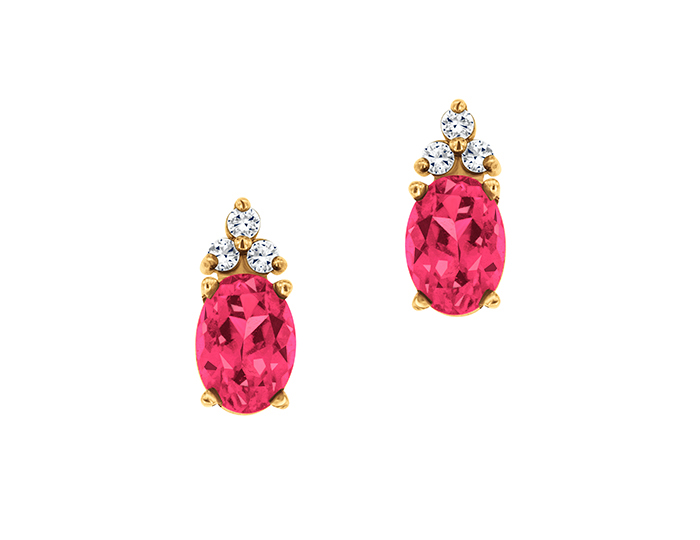 Pink sapphire and round brilliant cut diamond earrings in 14k yellow gold.