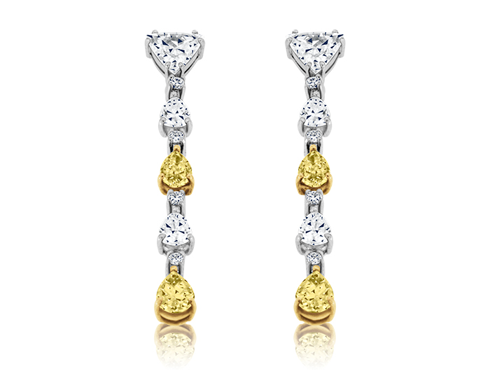 Yellow diamonds with marquise and pear shape diamond earrings in platinum.