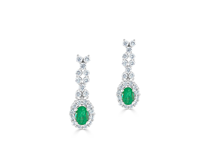 Emerald and round brilliant cut diamond earrings in 18k white gold.