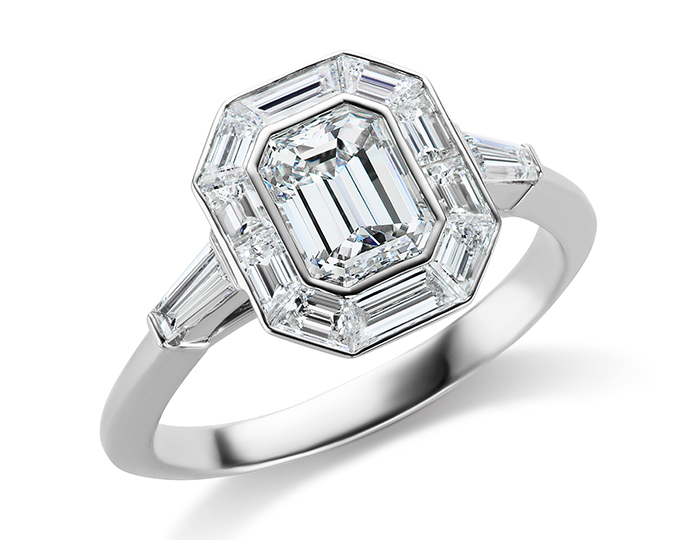 Emerald cut and baguette cut diamond engagement ring in platinum.