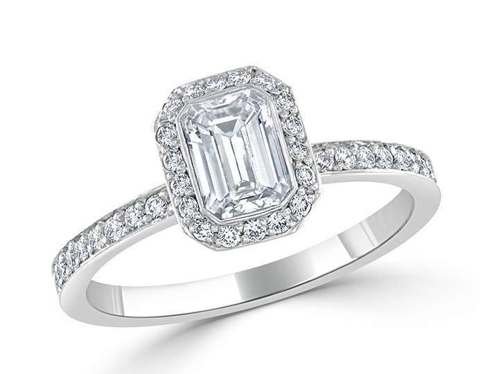 Bez Ambar emerald cut and round brilliant cut diamond engagement ring in platinum.