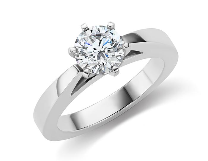 Round brilliant cut diamond solitaire engagement ring in platinum.