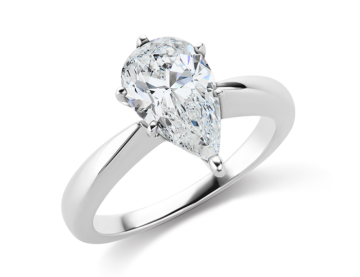 Pear shape diamond solitaire engagement ring in 18k white gold.