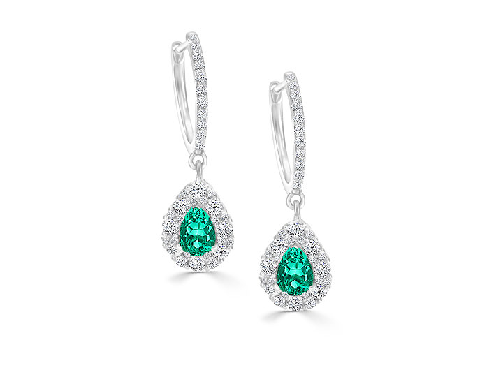 Pear shape emerald and round brilliant cut diamond earrings in 18k white gold.