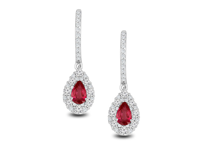 Pear shape ruby and round brilliant cut diamond earrings in 18k white gold.
