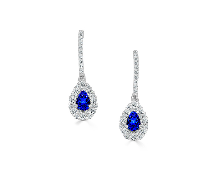 Pear shape sapphire and round brilliant cut diamond earrings in 18k white gold.