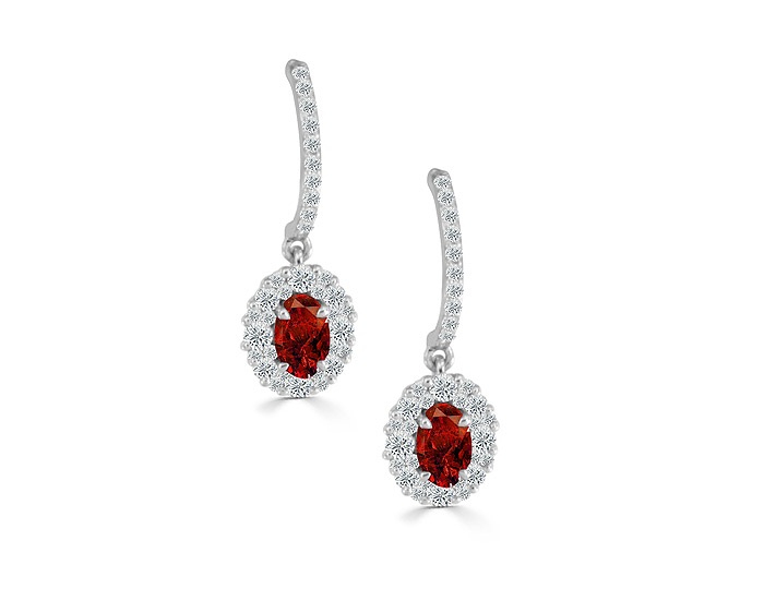 Oval shape ruby and round brilliant cut diamond earrings in 18k white gold.