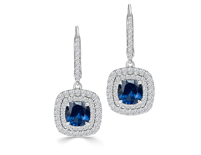 Cushion cut sapphire and round brilliant cut diamond earrings in 18k white gold.