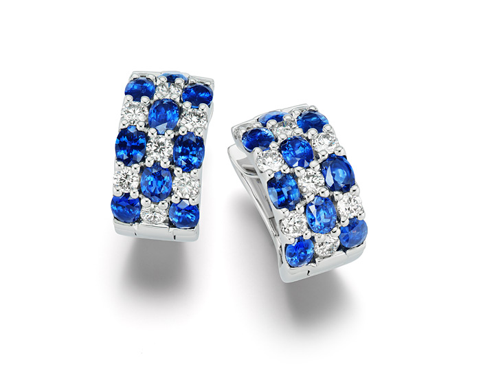 Oval sapphire and round brilliant cut diamond earrings in 18k white gold.