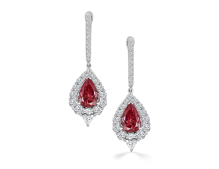 Pear shape ruby, pear shape diamond and round brilliant cut diamond earrings in 18k white gold.