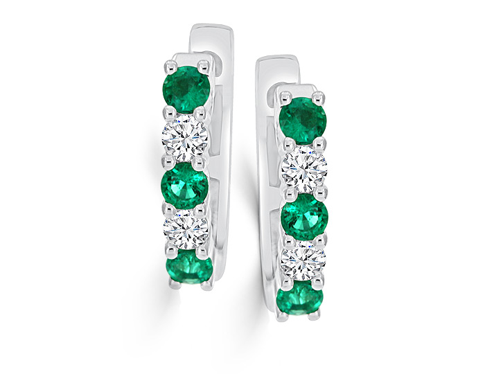 Round emerald and round brilliant cut diamond earrings in 18k white gold.