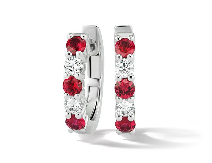 Round ruby and round brilliant cut diamond earrings in 18k white gold.