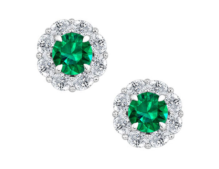 Emerald and oval shape diamond earrings in 18k white gold.