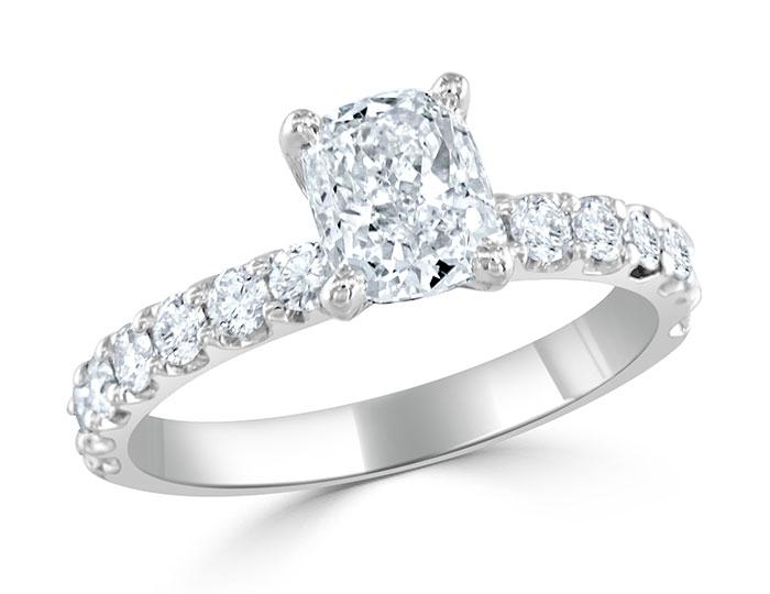 Cushion and round brilliant cut diamond engagement ring in platinum.