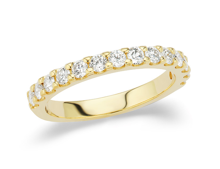 Round brilliant cut diamond band in 18k yellow gold.
