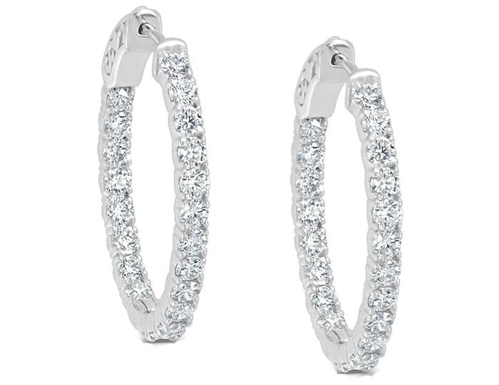 "Round brilliant cut diamond 0.75"" oval hoop earrings in 18k white gold."