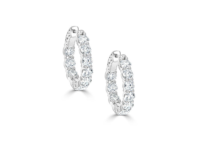 Round brilliant cut diamond hoop earrings in 18k white gold.