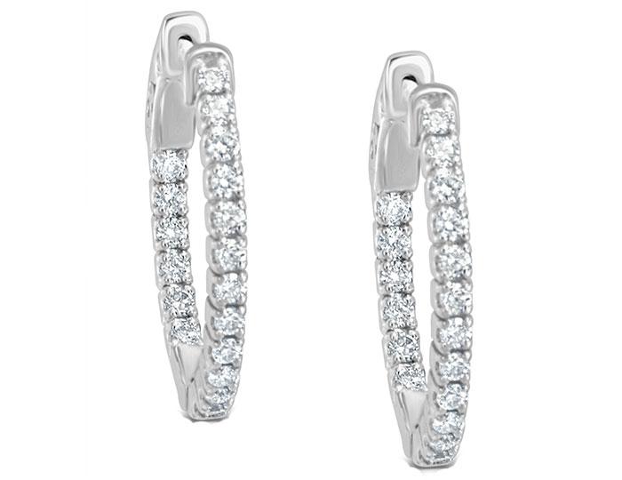 "Round brilliant cut diamond 0.60"" oval hoop earrings in 18k white gold."