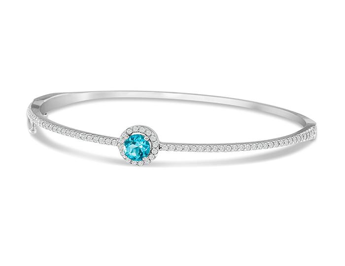 Blue topaz and round brilliant cut diamond bracelet in 18k white gold.