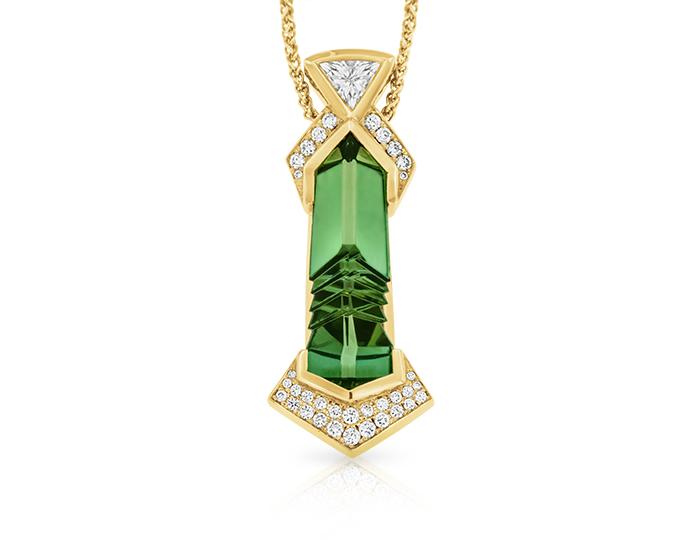 Bernd Munsteiner cut green tourmaline and round brilliant cut diamond pendant in 18k yellow gold.