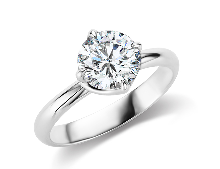 Round brilliant cut solitaire diamond engagement ring in platinum.
