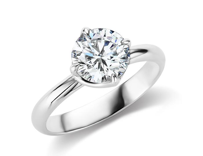 Round brilliant cut solitaire diamond engagement ring in platinum.