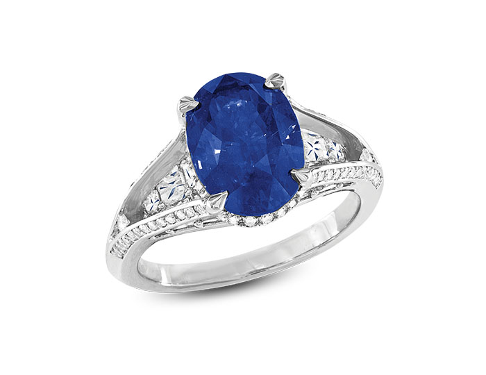 Sapphire ring with blaze cut and round brilliant cut diamonds in 18k white gold.