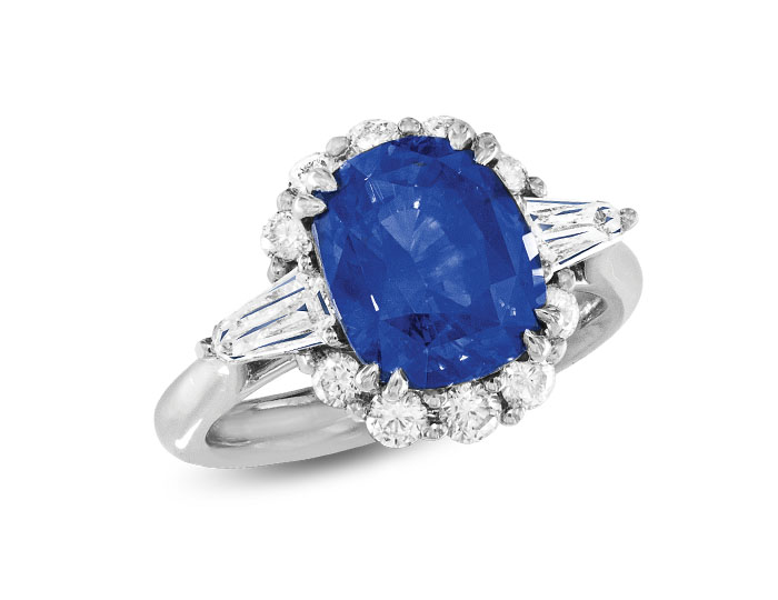 Sapphire ring with kite and round brilliant cut diamonds in platinum.