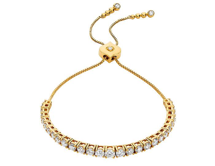 Sara Weinstock Isadora collection round brilliant cut diamond bracelet in 18k yellow gold.